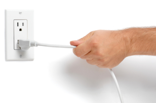 Man yanking electrical cord
