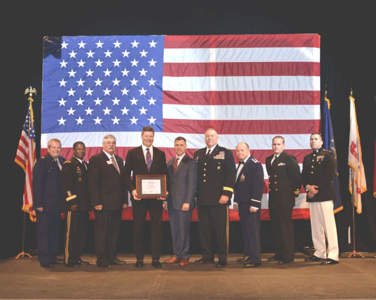 David Meyers is shown with Congressman Jim Banks (IN-03) and military leaders representing various branches of service at the Employer Awards Banquet in Indianapolis.