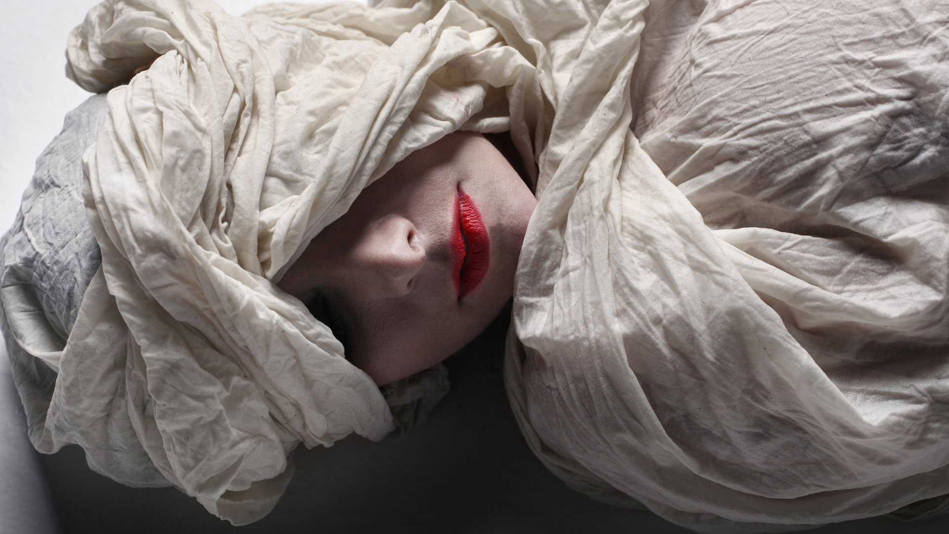 Model wrapped in funeral shroud