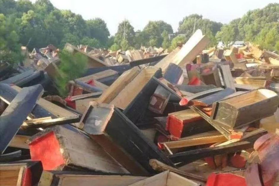 Piles of wooden coffins
