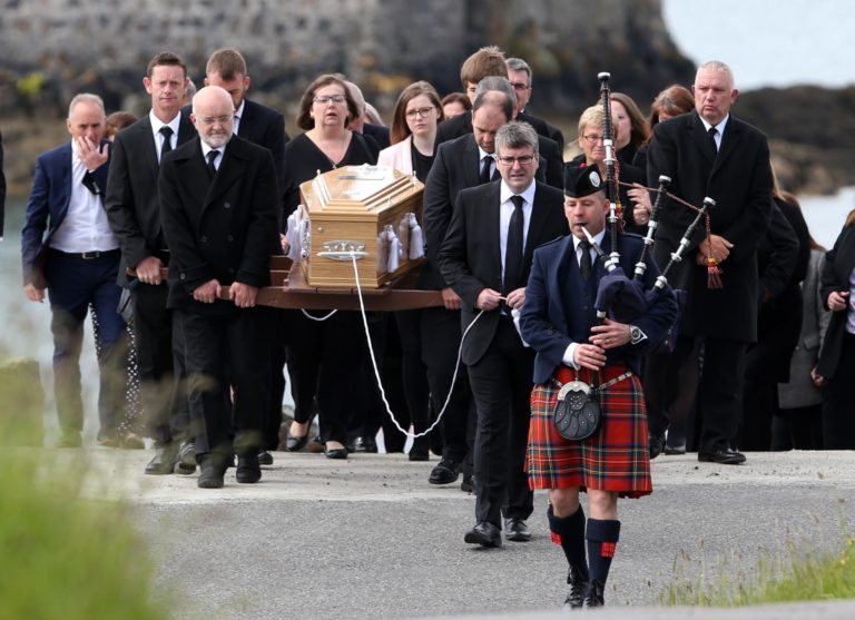 Scottish bagpiper leads funeral procession