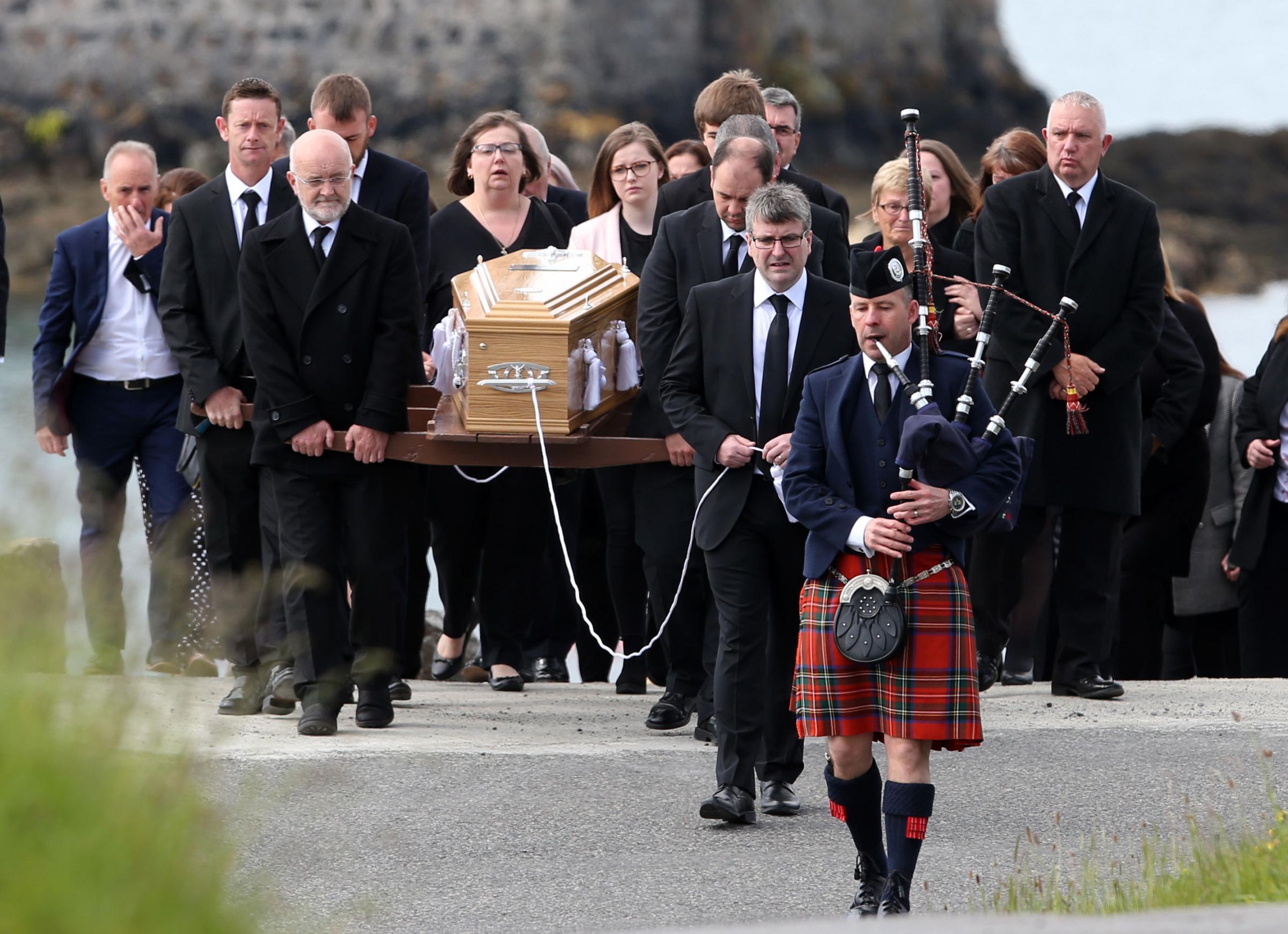 Scottish bagpiper leads funeral procession