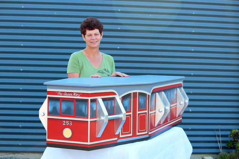 Coffin painted like a tram