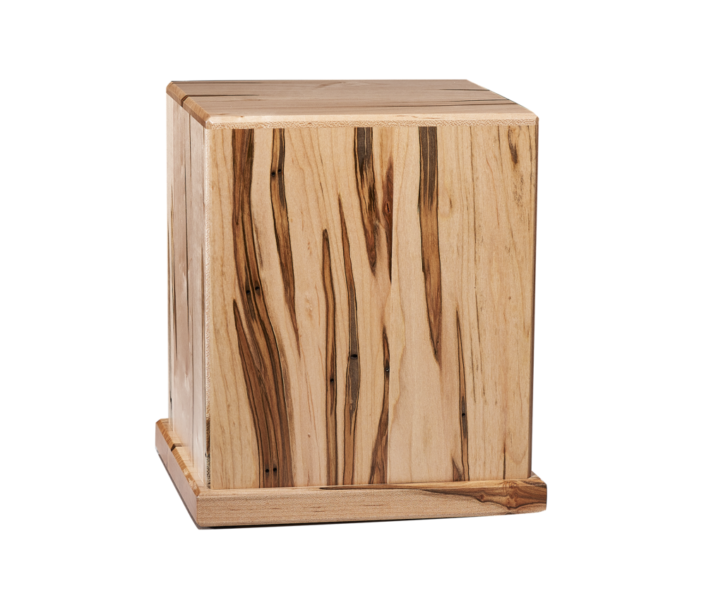 The new Ambrosia Maple urn is crafted of solid maple urn featuring a unique graining pattern and a contemporary design. It is one several news urns recently introduced by the Davis Whitehall Co.