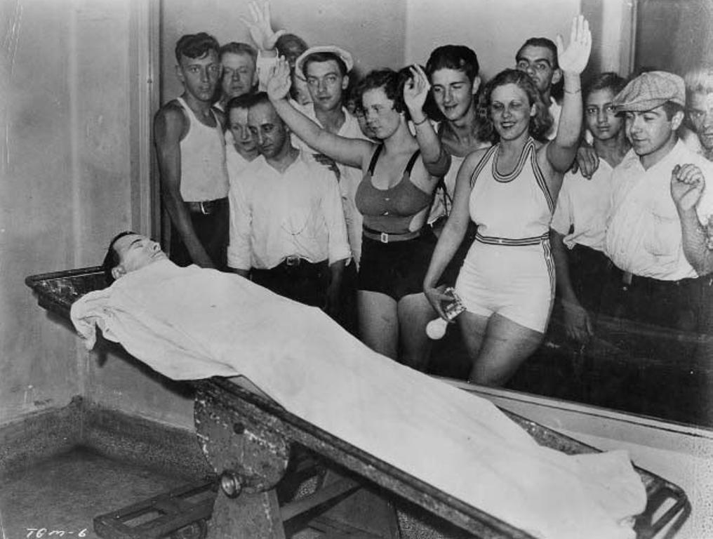 Dillinger body on table with crowd of specatators