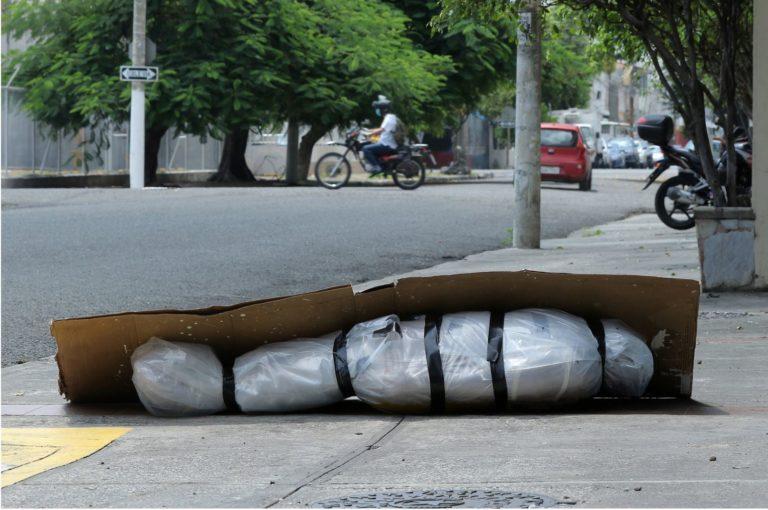 Body on the sidewalk in Ecuador